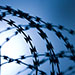 Funds Keep Buying — and Selling — Private Prison Stocks