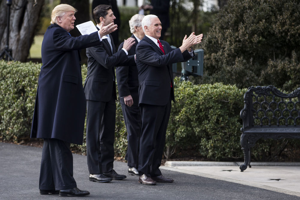 President Donald Trump and other Republicans celebrate the passage of the tax bill in December 2017. (Zach Gibson/Bloomberg)