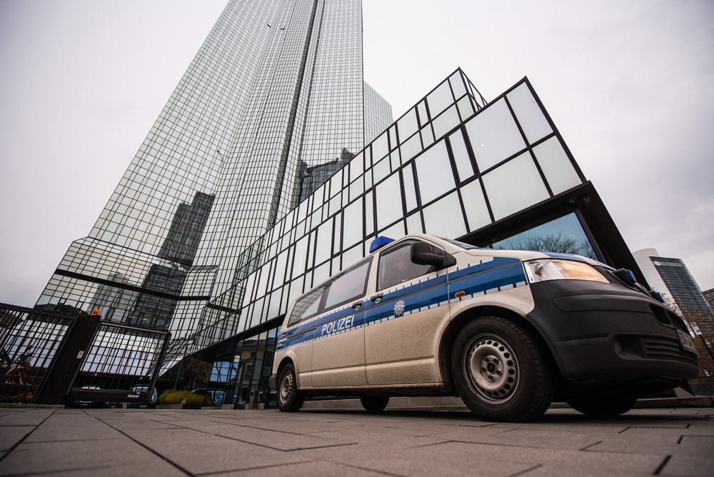 A police van sits outside the headquarters of Deutsche Bank on Nov. 29, 2018. (Andreas Arnold/Bloomberg)