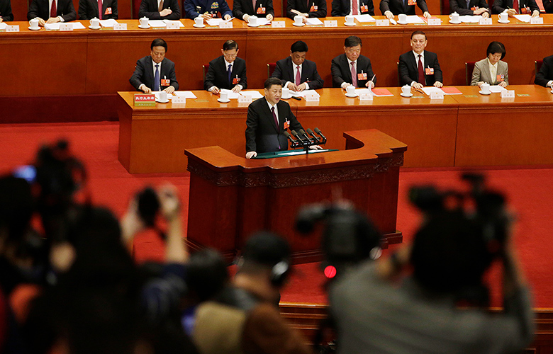 Xi Jinping, center, speaks at the National People's Congress (Qilai Shen/Bloomberg)