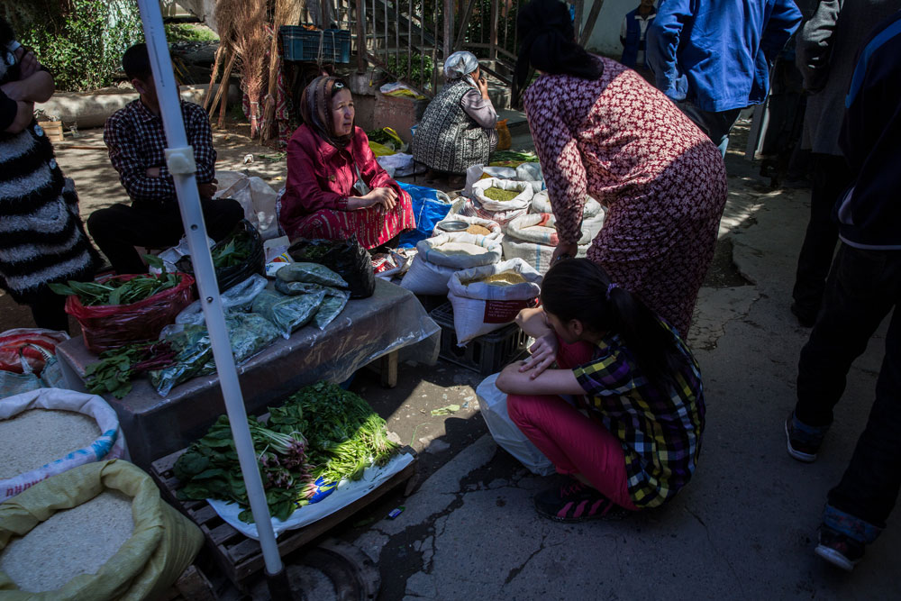 Shoppers browse a vegetable stall at a market in Dushanbe, Tajikistan. (Taylor Weidman/Bloomberg)