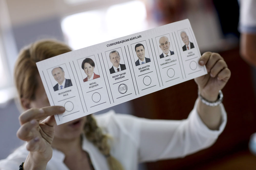 An election official displays a ballot in Turkey during last month's vote. (Kostas Tsironis/Bloomberg)