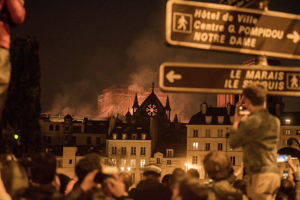 Watching the fire burn at Notre-Dame Cathedral in Paris. (Martin Barzilai/Bloomberg)