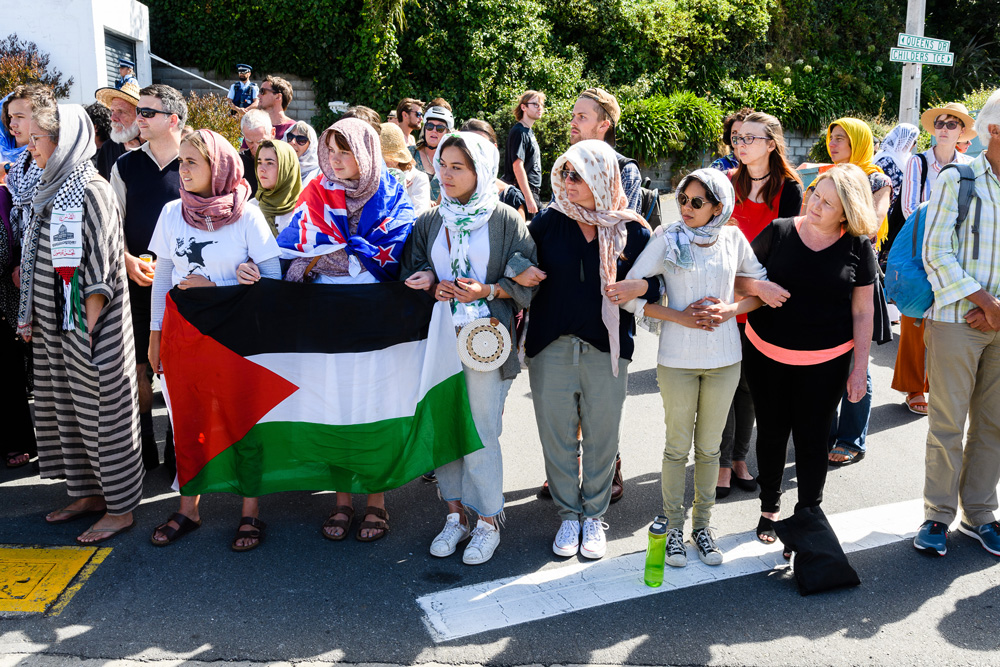 People gather to honor the victims of the Christchurch terrorist attack outside the Kilbernie Mosque in Wellington, New Zealand. (Mark Coote/Bloomberg)